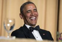U.S. President Barack Obama laughs at a joke during the White House Correspondents' Association Dinner